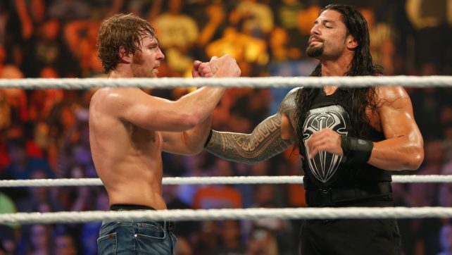 NEW YORK, NY - AUGUST 23: Dean Ambrose and Roman Reigns celebrate their victory at the WWE SummerSlam 2015 at Barclays Center of Brooklyn on August 23, 2015 in New York City. (Photo by JP Yim/Getty Images)